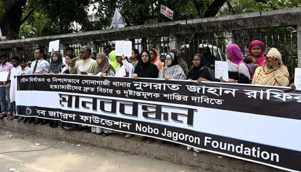 Bangladeshis attend a protest in Dhaka following Nusrat Jahan Rafi's murder by being set on fire aft