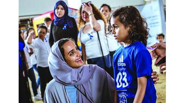 HE Sheikha Hind interacts with a child at QF's World Autism Awareness Day event