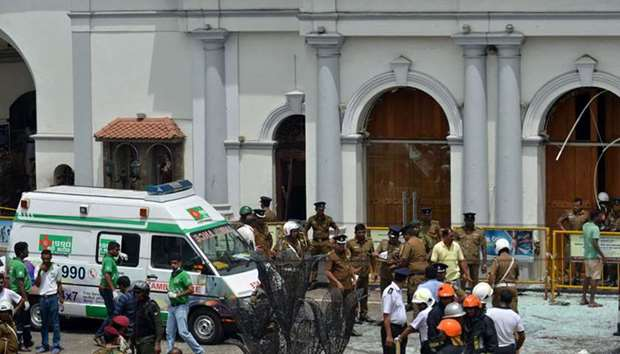 Sri Lankan military officials stand guard in front of the St. Anthony's Shrine, Kochchikade church a