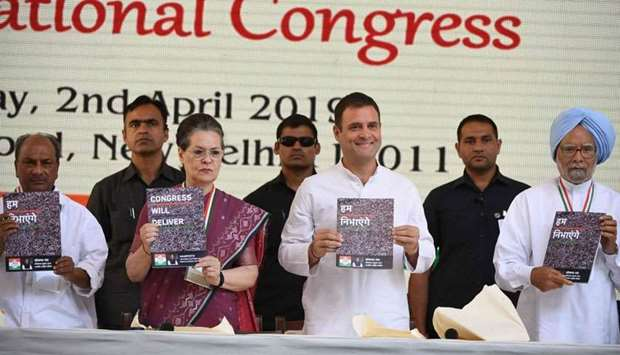 Indian National Congress party president Rahul Gandhi (centre R) and the party's former president So