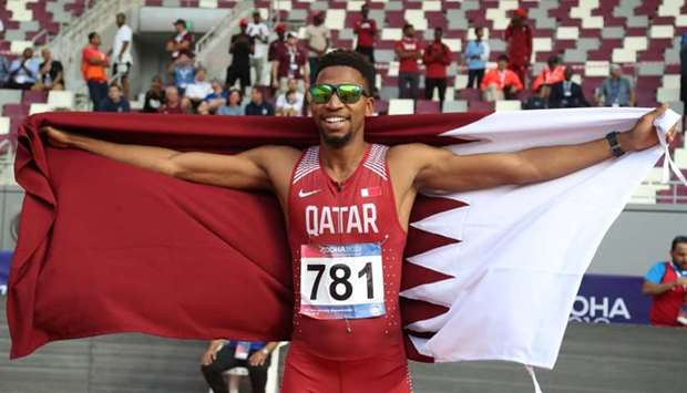 Qatar's Abderrahman Samba celebrates winning the men's 400m hurdles final