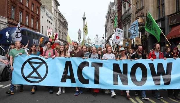 Climate change activists from the group Extinction Rebellion march down Whitehall as they protest in