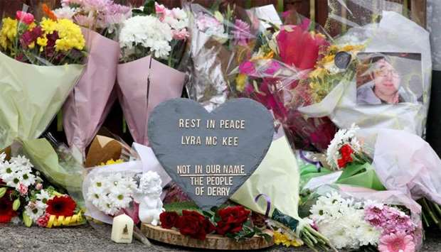 Floral tributes and a plaque condemning the killing of journalist Lyra McKee are seen at the scene o
