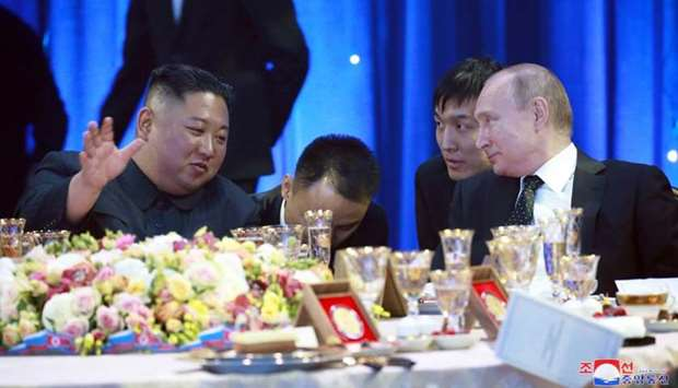 North Korean leader Kim Jong Un and Russian President Vladimir Putin attend an official reception fo