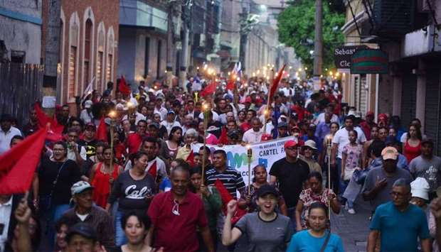 Hondurans demonstrate with torches against the approval of education and health bills demanding the