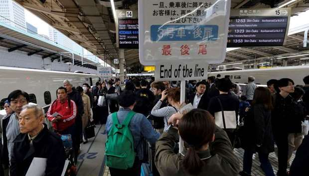 Passengers wait for a train at Tokyo railway station, beginning of the unprecedented 10-day Golden W