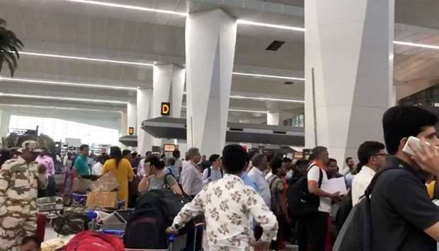 Crowds of people are seen at the Indira Gandhi International Airport in Delhi, India,