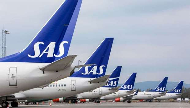 SAS airplanes are seen parked on the tarmac as SAS pilots go on strike at Oslo Airport in Gardermoen