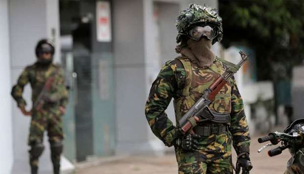 Sri Lankan Special Task Force soldiers stand guard