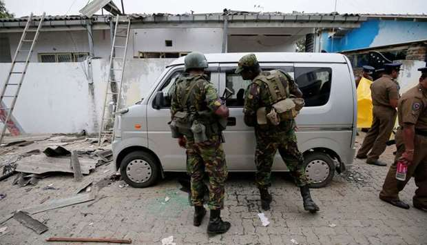 Security personnel at the site of an overnight gun battle, between troops and suspected militants, o
