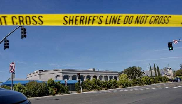 Sheriff's crime scene tape is placed in front of the Chabad of Poway Synagogue after a shooting in P