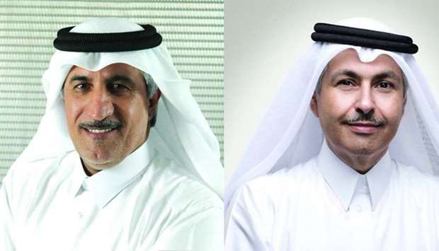 Ooredoo Group chairman HE Sheikh Abdulla bin Mohamed bin Saud al-Thani(L), Chief Executive Officer S