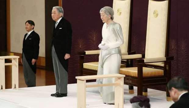 Japan's Crown Prince Naruhito (L), Emperor Akihito (C) and Empress Michiko (R) attend the abdication