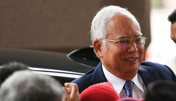 Malaysia's former prime minister Najib Razak arrives at a court for his trial over 1MDB corruption a
