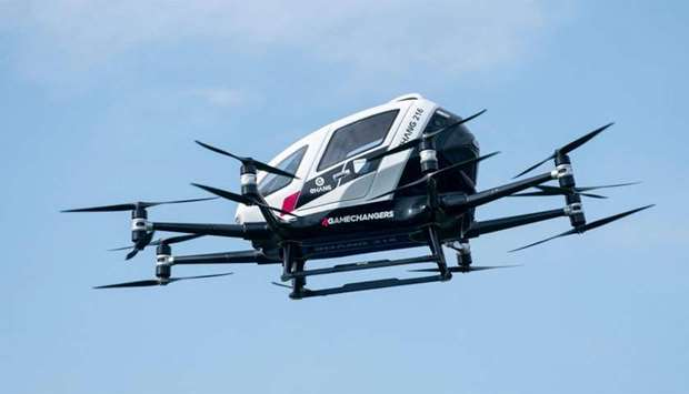 """An unmanned Air Taxi EHANG 216 takes off during a press preview of FACC AG on """"Urban Air Mobility"""" a"""