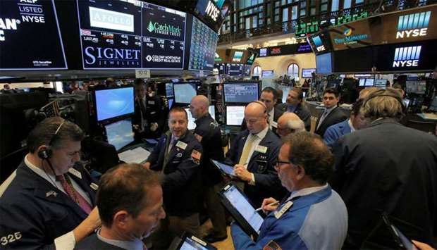 Traders work on the trading floor at the New York Stock Exchange in Manhattan