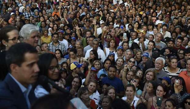 Supporters of Venezuelan opposition leader and self-proclaimed interim president Juan Guaido listen