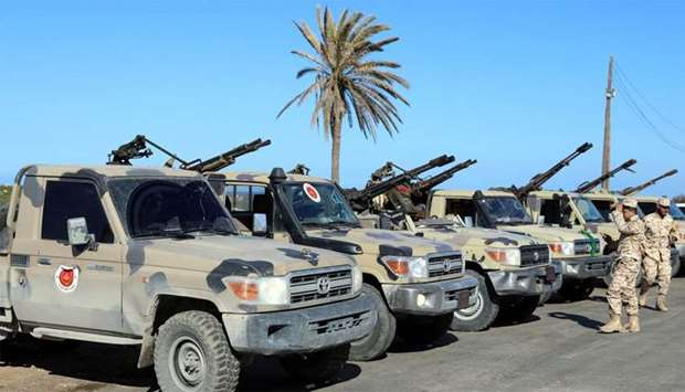 Military vehicles of Misrata forces, under the protection of Tripoli's forces, are seen in Tajura ne