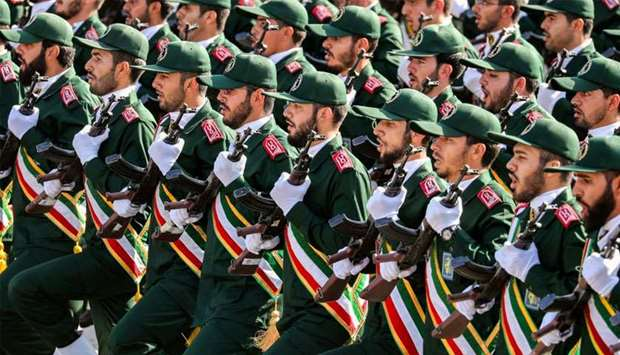 Members of Iran's Revolutionary Guards Corps (IRGC) march during a military parade