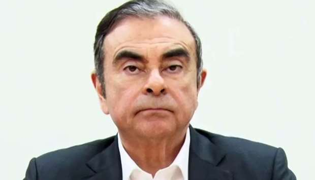 Ghosn preparing to speak at the beginning of a video message