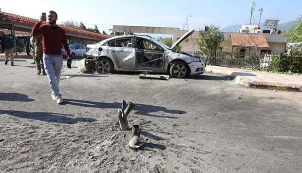 An damaged vehicle in Hama after a missile strike by militants on April 7.
