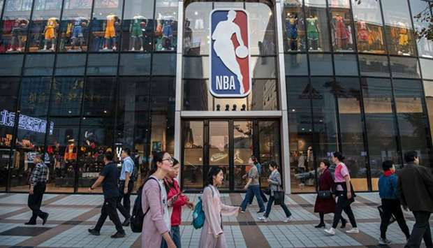People walk by the NBA flagship retail store on October 9, 2019 in Beijing, China. (TNS)