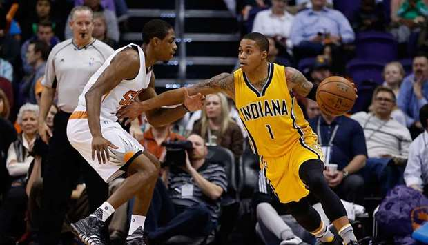 In this file photo taken on January 19, 2016, Joe Young (right) of the Indiana Pacers controls the b