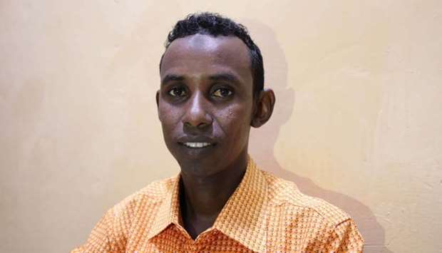 Mohamed Omar Abukar, a Somali student, talks during an interview with Reuters after his mother and n