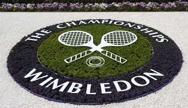 A Wimbledon logo is seen inside the grounds at the Wimbledon tennis championships in London