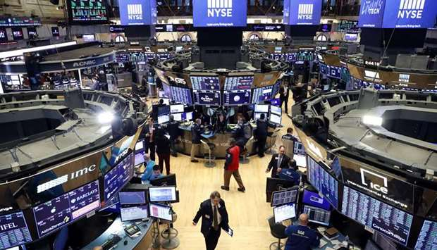 Traders work on the floor of the New York Stock Exchange. Investors are bracing for the most volatil