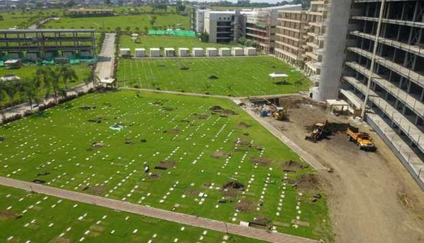 Aerial view of new graves at the Jardines de la Esperanza cemetery in Guayaquil, Ecuador yesterday a