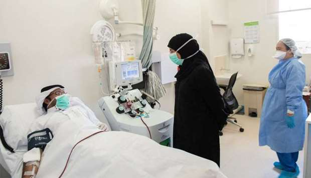 HE the Minister interacts with a patient undergoing treatment