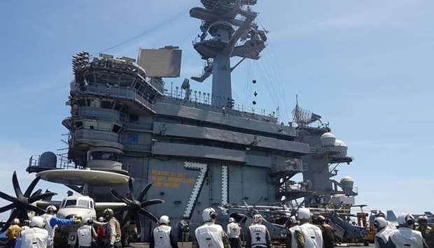 A busy day on the flight deck of the USS Theodore Roosevelt while transiting the South China Sea Apr