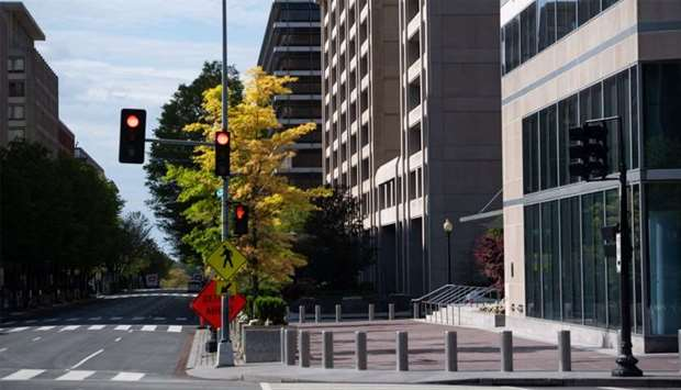 A deserted street is seen outside the headquarters of the International Monetary Fund (IMF) as the I