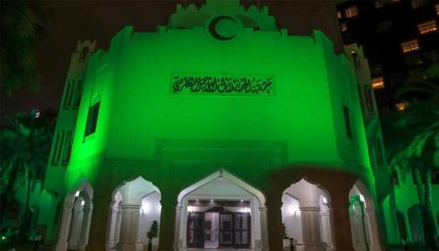 The QRCS building lit up in green.