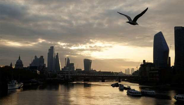 The city of London financial district and the river Thames are seen in early morning, as the spread