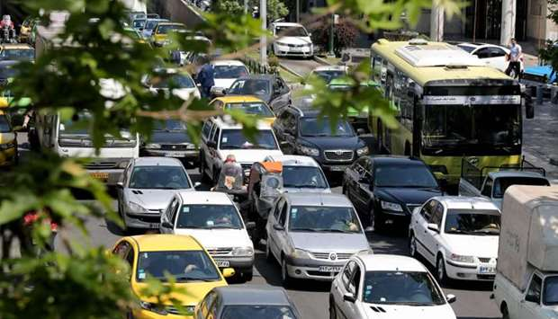Cars pack a street in the Iranian capital Tehran, on April 18 after authorities eased lockdown measu