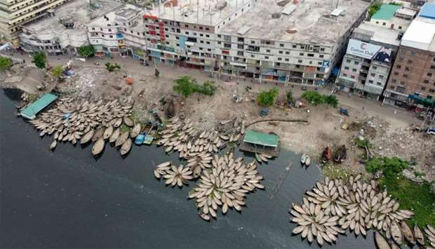 This aerial picture shows boats docking on the bank of a river during a government-imposed lockdown