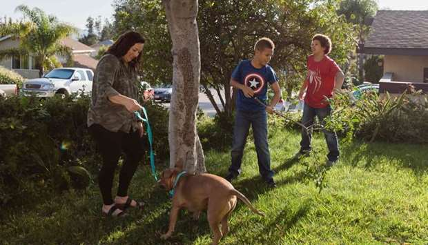 Jalene, Desean, Delonte & Mase a pit bull, play in front of  Hillery home in Escondido, California