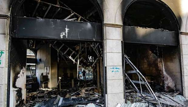 The aftermath of a bank set ablaze overnight by some protesters following a demonstration over the c