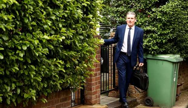 Britain's Labour Party leader Keir Starmer leaves his home in London