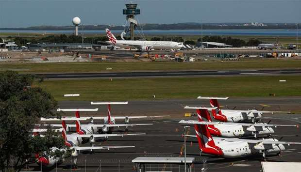 Grounded aircraft operated by Virgin Australia Holdings stand on the tarmac at Sydney Airport.