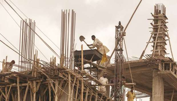Workers at a construction site in Karachi. The federal government of Pakistan has worked out the imp