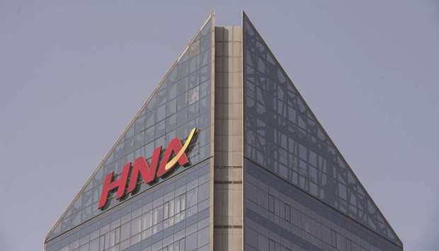 Signage for HNA Group is displayed atop the company's building in Beijing. The company appointed Hou