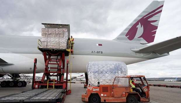 Qatar airways plane unloading sanitary and protection material in Madrid