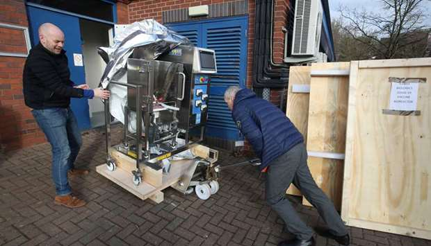 Engineers outside Cobra Biologics, arrive with a bioreactor in the hope of developing a vaccine agai
