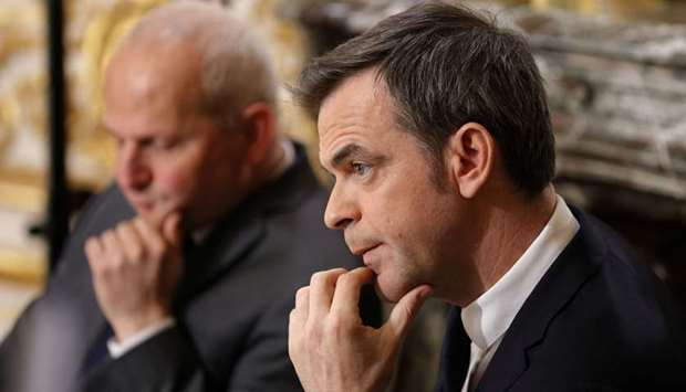 French Minister for Solidarity and Health Olivier Veran March looks on during a news conference in P