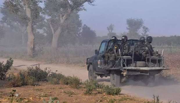 Members of the Cameroonian Rapid Intervention Force patrol the outskirts of Mosogo