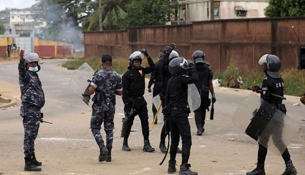 Riot police are seen as they try to stop protesters who ransacked a half-built makeshift hospital fo