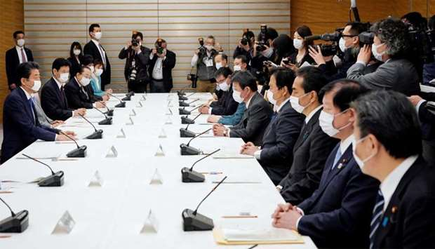 Japan's Prime Minister Shinzo Abe speaks during a meeting about the measures against the coronavirus